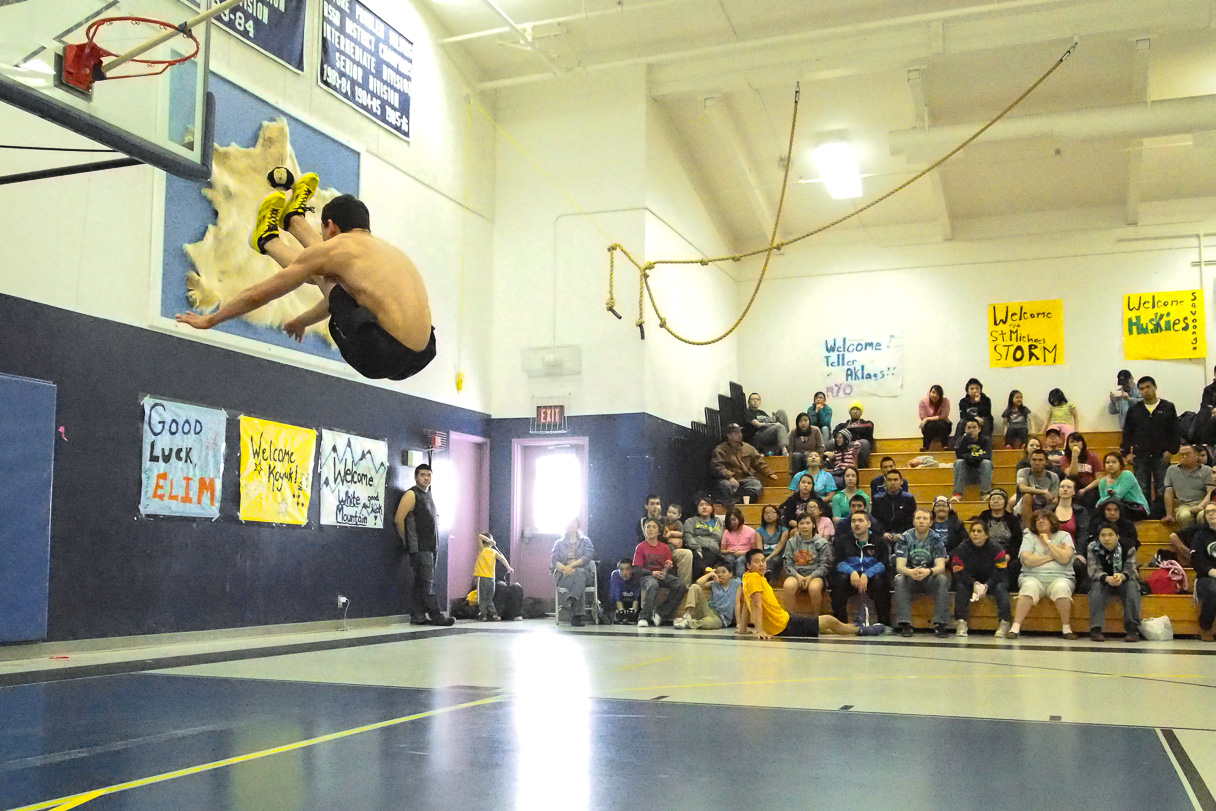 Aucha Johnson of Unalakleet two-foot high-kicking at BSSD's NYO tournament in Gambell. Photo Credit: KNOM (2014)