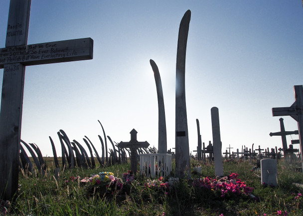 The fencing of Tikiġaq's cemetery, and many of the headstones, are made of bowhead jawbones that were once spread across the point. In the 19th century missionaries consolidated the remains. Photo: Zachariah Hughes, KNOM.