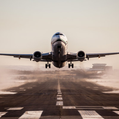 An Alaska Airlines jet takes off at the Nome airport. Photo: David Dodman. Used with permission.