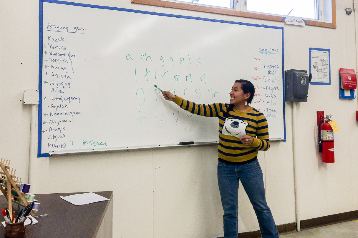 Inupiaq teacher Marjorie Tahbone points to a whiteboard during a language class.