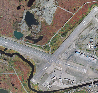Bird's eye view of Nome's airport. Nome Gold's property is to the east of the east/west runway. Photo: Alaska Department of Transportation.
