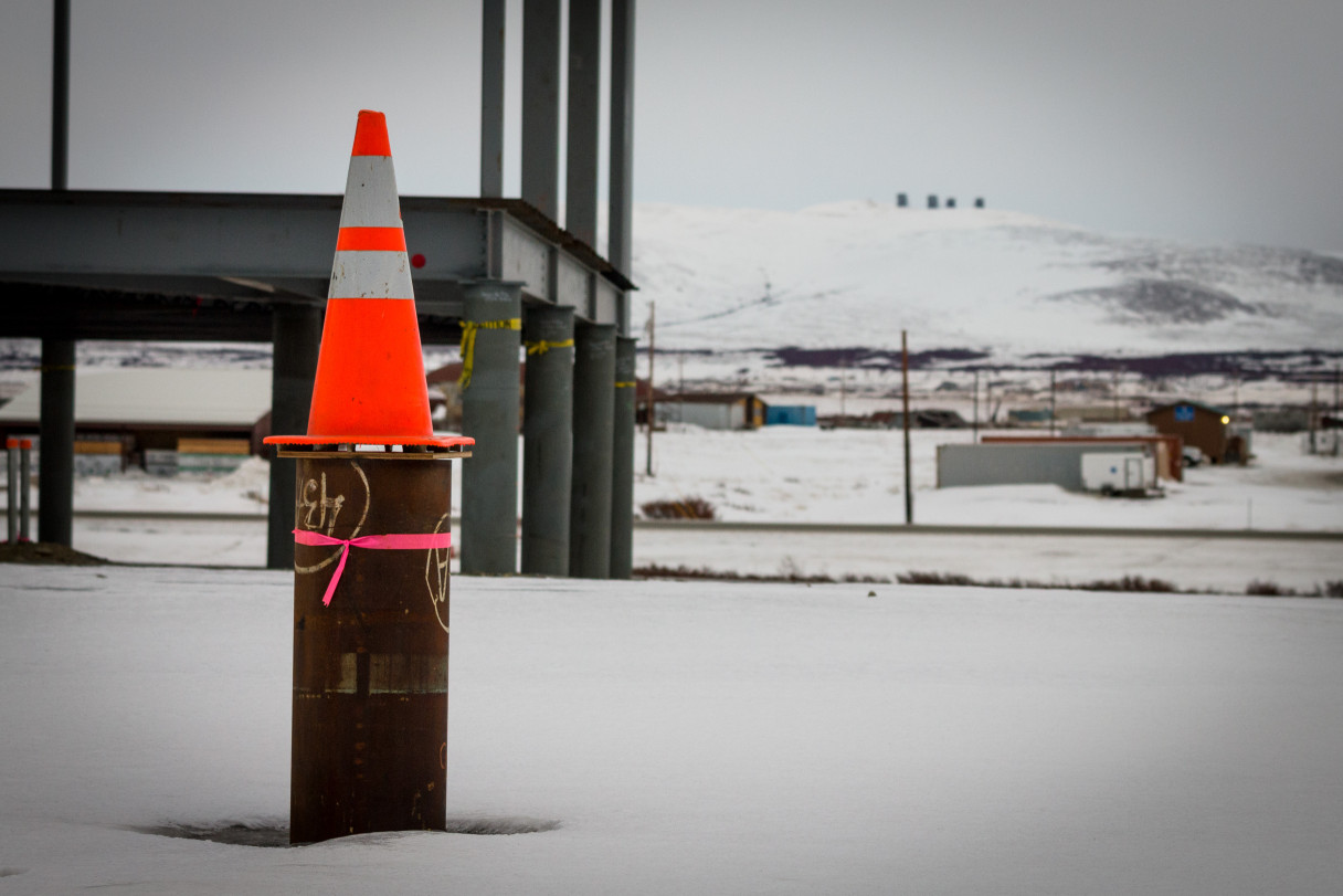 The Richard Foster Building, currently under construction, with Nome's Anvil Mountain and White Alice site in the background. Photo: Matthew F. Smith, KNOM.