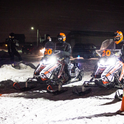 Iron Dog victors Eric Quam and Scott Faeo leave the Nome halfway point amid blowing snow days before winning the 2015 race in Fairbanks. Photo: Jenn Ruckel, Francesca Fenzi, KNOM.