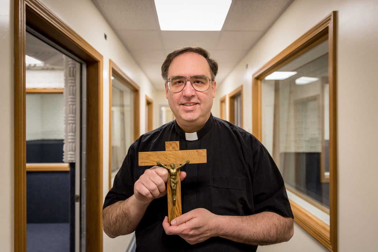 Father Ross Tozzi in KNOM's new digital studios