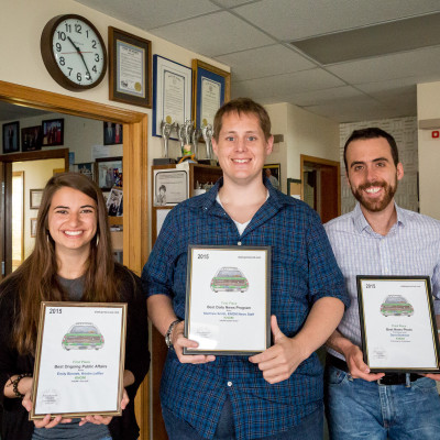 Kristin, Matthew, and David, holding AK Press Club awards