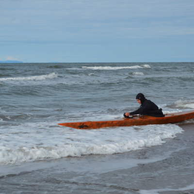 Our friend Maligiaq kayaks off the coast of Wales!