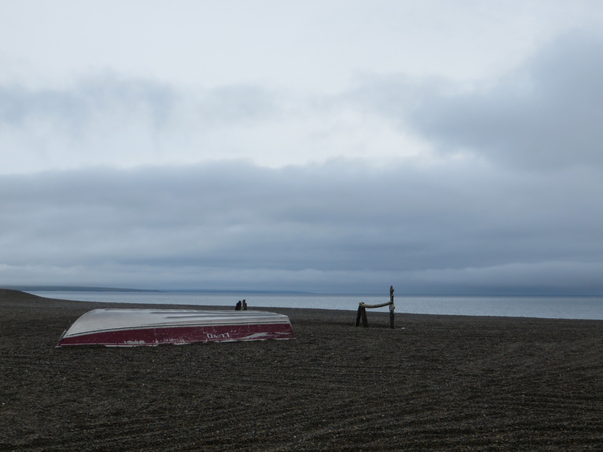 A boat resting on the beach on a cloudy summer day in Gambell, Alaska.