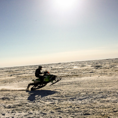 Racer in 2016 Nome-Golovin Snowmachine Race Photo: Mitch Borden, KNOM.