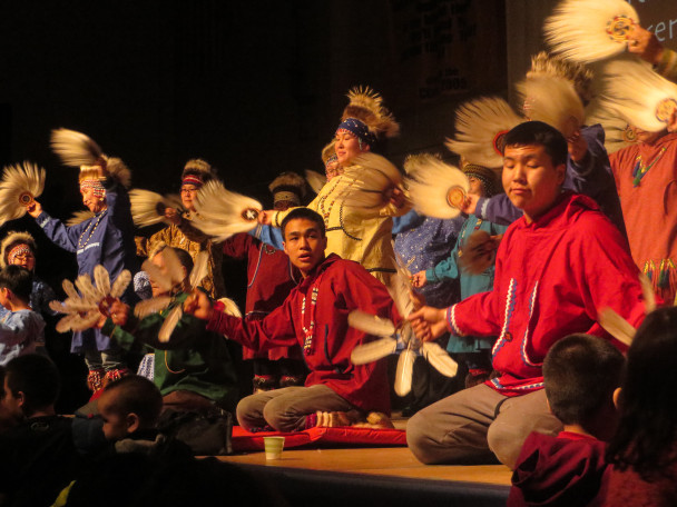 Byron Nicholai dances with the Toksook Bay Traditional Dancers . (Photo: Laura Kraegel, KNOM)