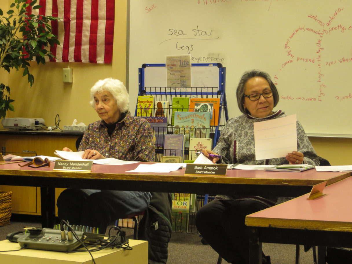 School Board Member Nancy Mendenhall and Board President Barb Amarok review the budget for Nome Public Schools. Photo: Laura Kraegel, KNOM.
