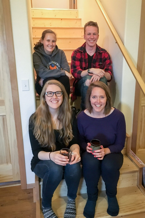 Our 2015-2016 class of KNOM volunteers — Maddie Winchester, Mitch Borden, Laura Kraegel, and Emily Russell — who collectively won a 2016 Alaska Press Club award for their ongoing writing for our volunteer blog. Photo: Margaret DeMaioribus, KNOM.