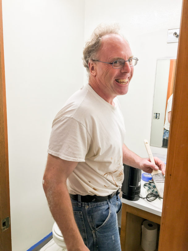 Father Tom Kuffel paints volunteer house