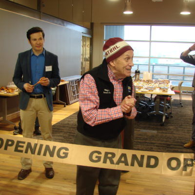 Nome Mayor Richard Beneville cuts the ribbon with representative Neal Foster to kickstart the opening of the cultural center, museum, and library in the Richard Foster Building.