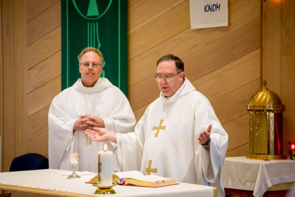 Father Tom and Father Ross at the altar, celebrating Mass