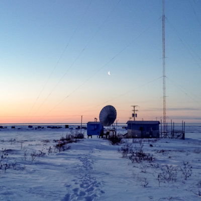The KNOM AM transmitter site, surrounded by snowy tundra.
