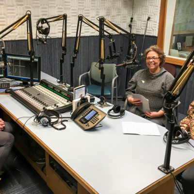 Inside KNOM studios, Josie Bourdon and Annie Conger record Inupiaq language lesson spots at KNOM with volunteer producer Lauren Frost.