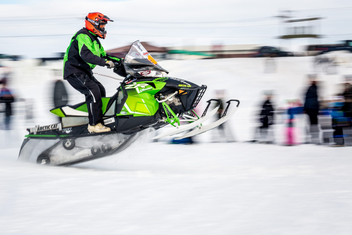 A Nome-Golovin racer speeds from the starting line on his snowmachine