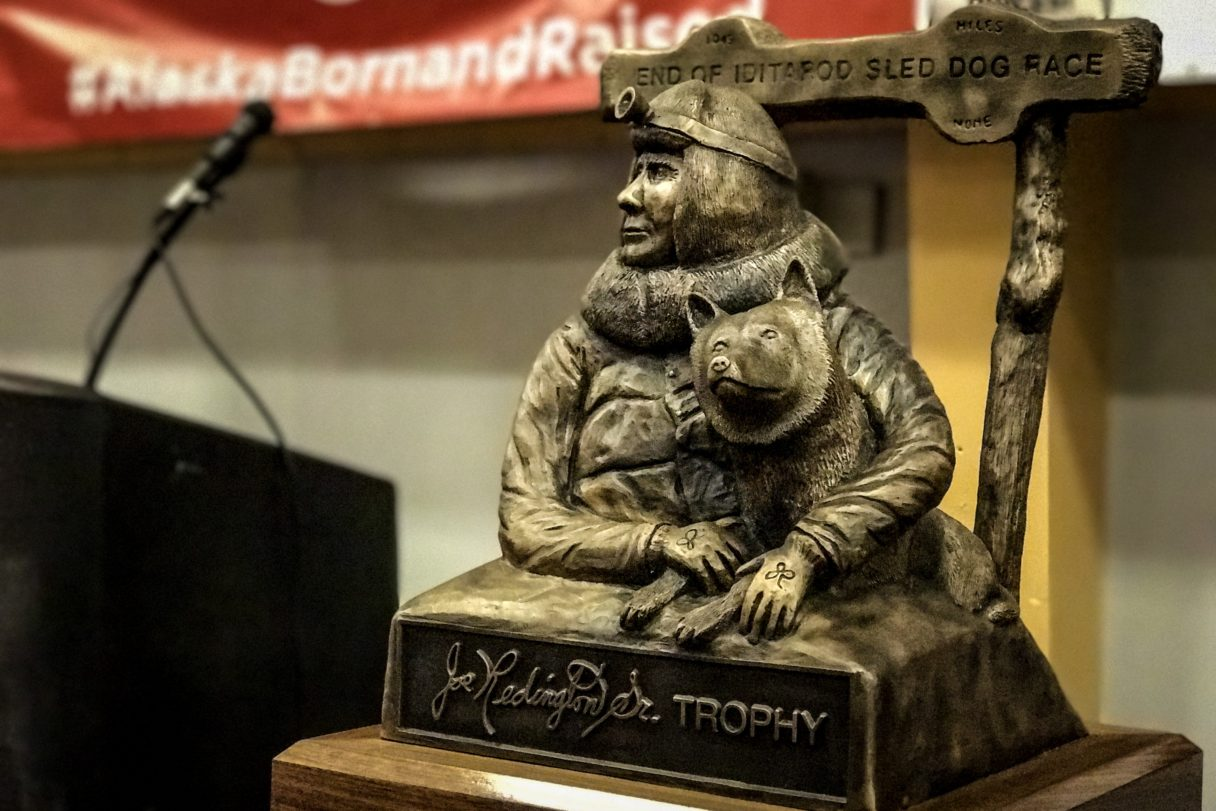 A trophy of Joe Redington, Sr. — known as the father of the Iditarod — awaits the 2017 champion at the finisher's banquet in Nome on Sunday afternoon.