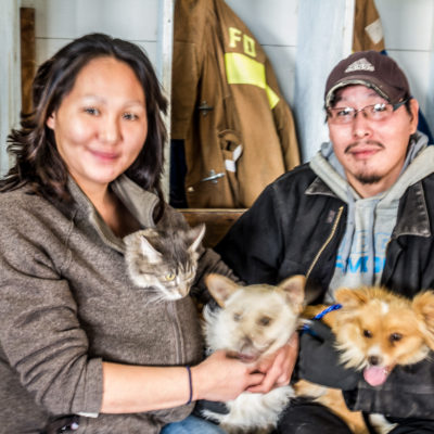 Eileen and Ashley Moses hold their pets inside the Elim Fire Hall