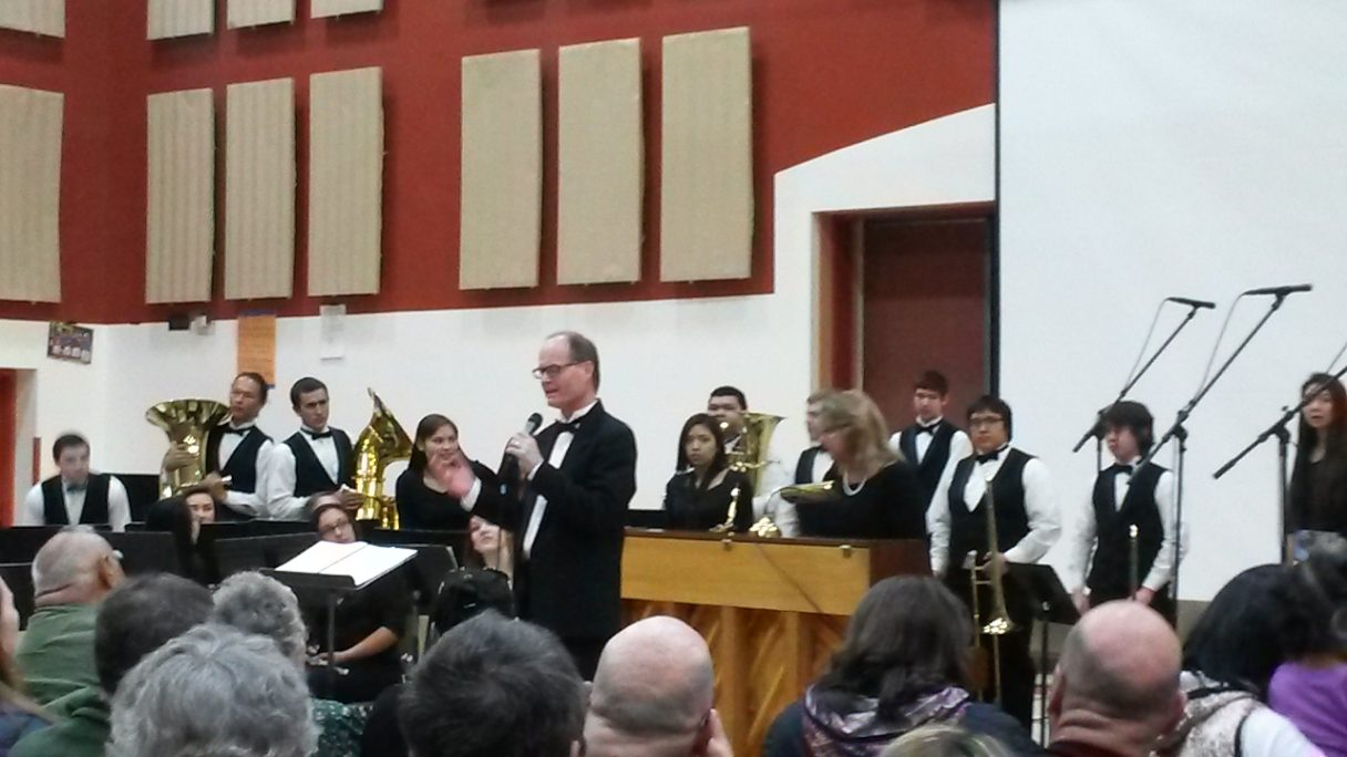 """Music Teacher Ron Horner introduces the world premiere of """"Between the Tundra and the Sky."""""""