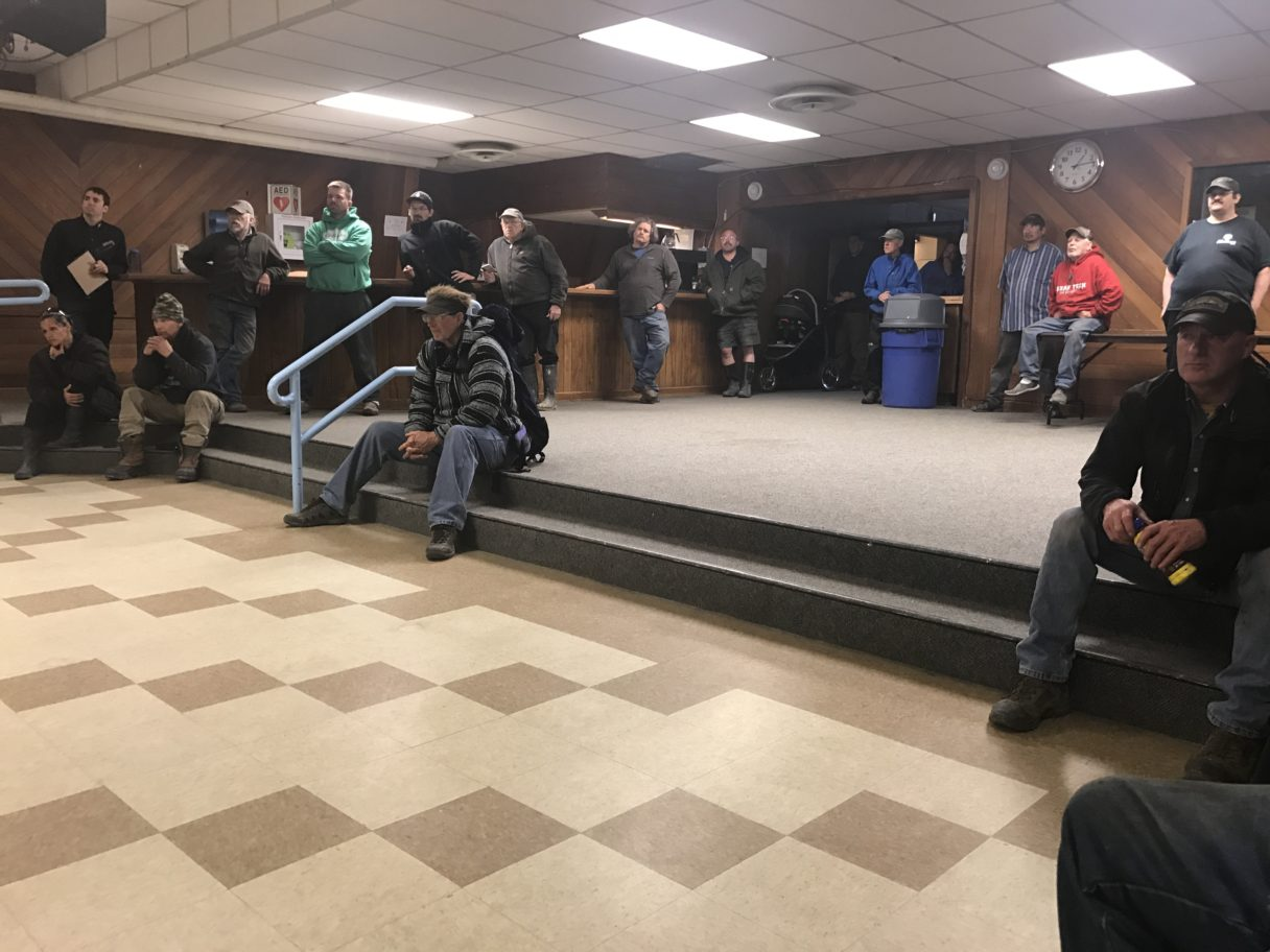 Dredge operators wait for the season's kick-off meeting to start in the Nome Mini Convention Center.
