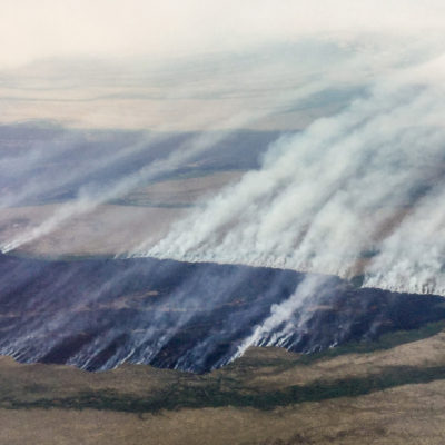 An aerial overview of a wildfire in southwestern Alaska