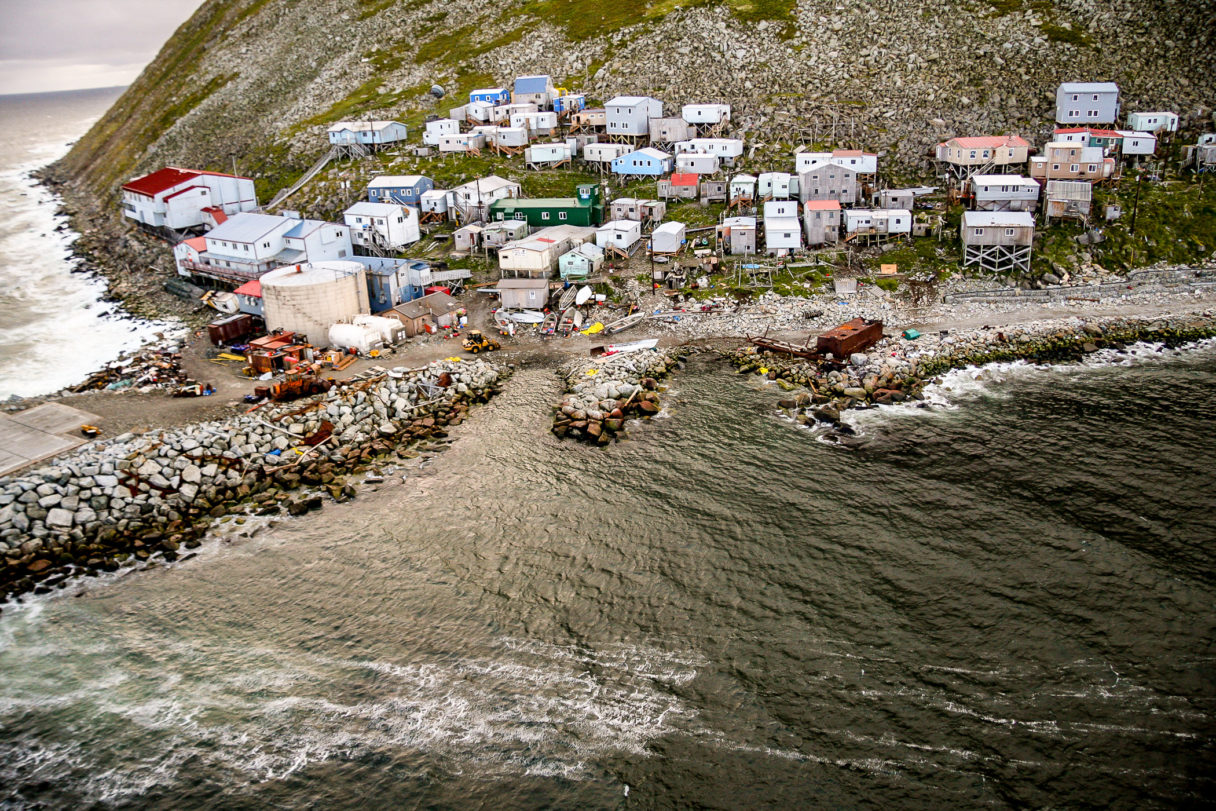 An aerial view of a small, coastal village