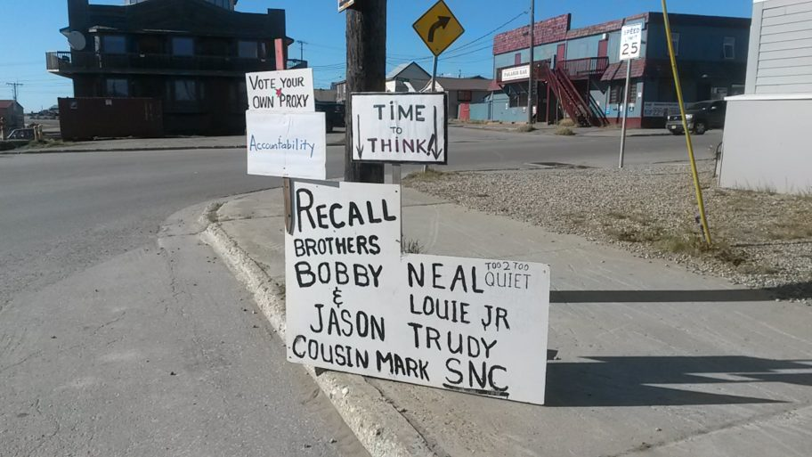 Signs posted on Nome's Front St. ahead of SNC's annual shareholder meeting. Photo Credit: KNOM's Karen Trop (2017)