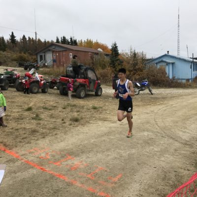 Nome's Jamie Yi crosses the finish line in White Mountain, 2017