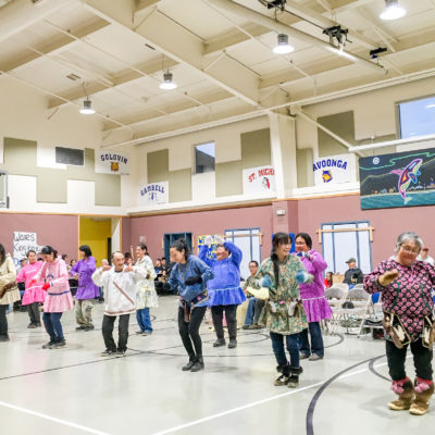 Alaska Native dancing inside the Wales gymnasium