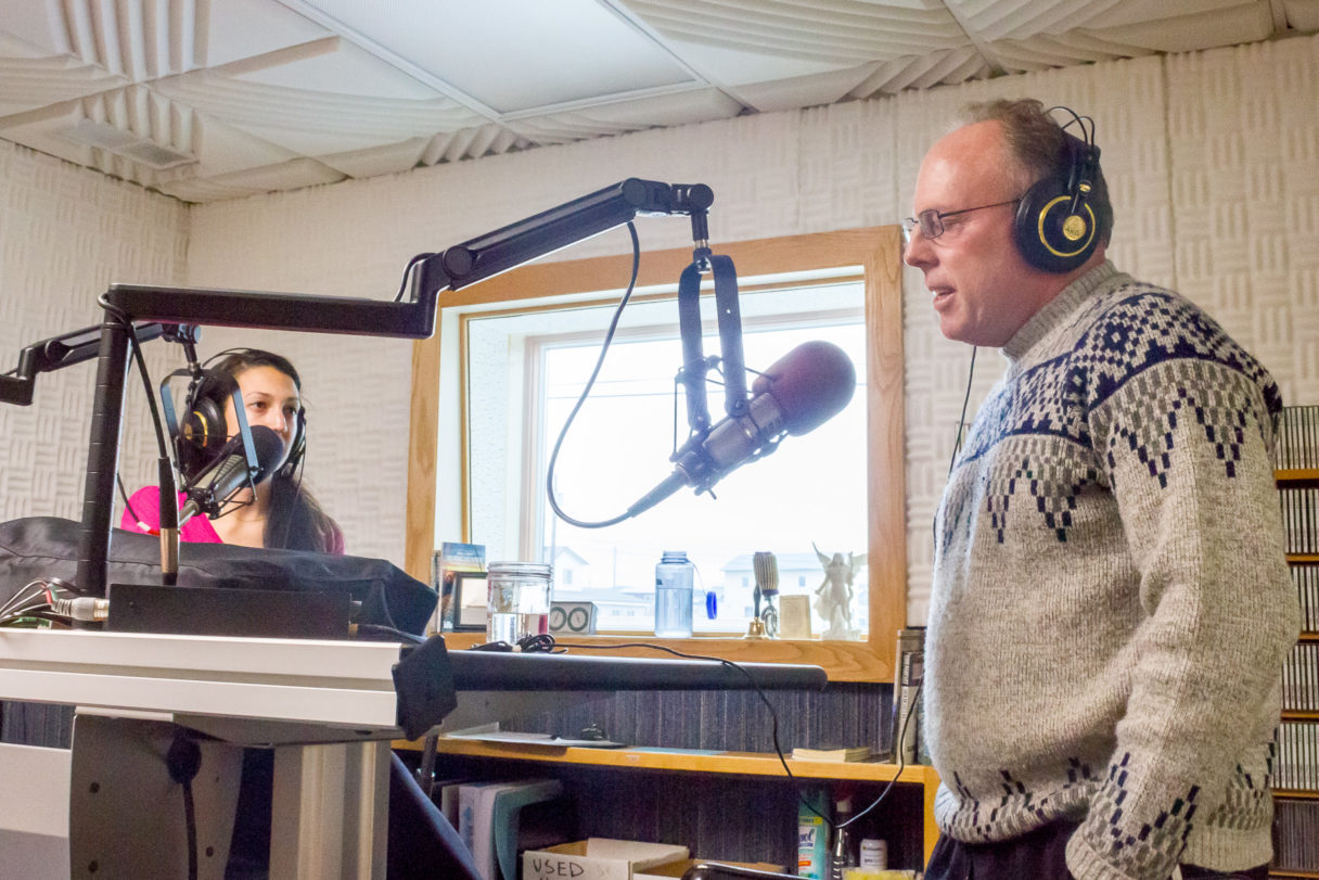 Margaret and Father Tom chat in KNOM's Studio A
