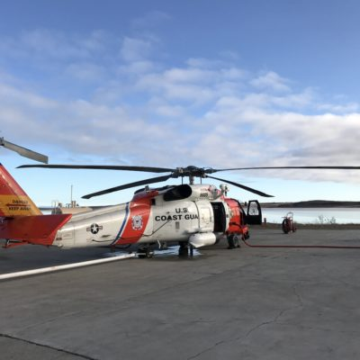 A Coast Guard helicopter lands at the seasonal base in Kotzebue.