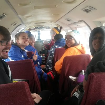 The Nome-Beltz cross-country team inside a Bering air plane, heading to Elim.