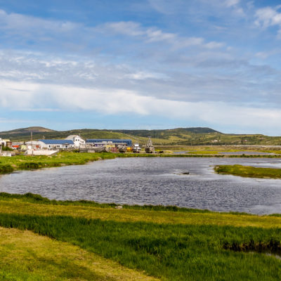 Landscape of rural Alaska town on a sunny summer day