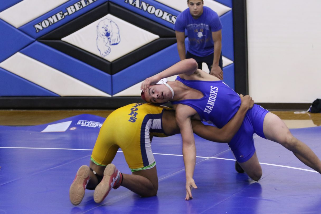 Nome's Aaron Rose wrestles a Bethel student at the 2017 Nome Invite (Photo: Janeen Sullivan, used with permission)