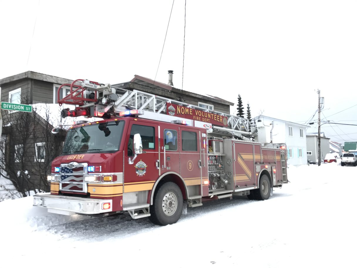 A fire engine from the Nome Volunteer Fire Department is parked on the snow-covered Division. Nome volunteer fire responded to a truck fire in the parking lot of Old St. Joe's.