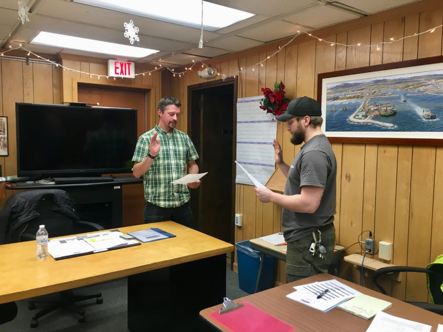 Russell Rowe is sworn in to the Nome Port Commission by Harbormaster Lucas Stotts on Dec. 14, 2017.