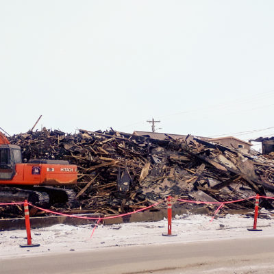 What remains of the Polaris is being demolished and removed by Q Trucking. Photo Credit: Davis Hovey, KNOM (2017)