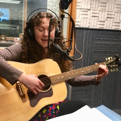 Sarah Hanson Hofstetter plays her guitar in the KNOM studios.