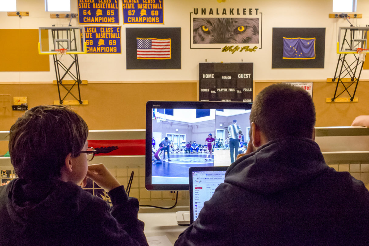 The BSSD Student Broadcasting team in action in Unalakleet, monitoring and capturing the action of the village's wrestling/cheerleading tournament.