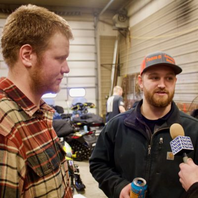 Casey Boylan of Team 14 and Brad George of Team 6 at the Public Works garage for layover maintenance work (Photo: Zoe Grueskin, KNOM)
