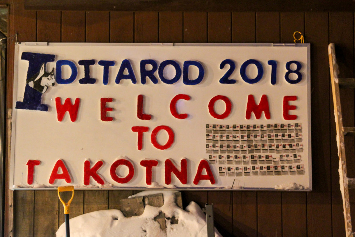 "Sign reading ""Iditarod 2018: Welcome to Takotna."""