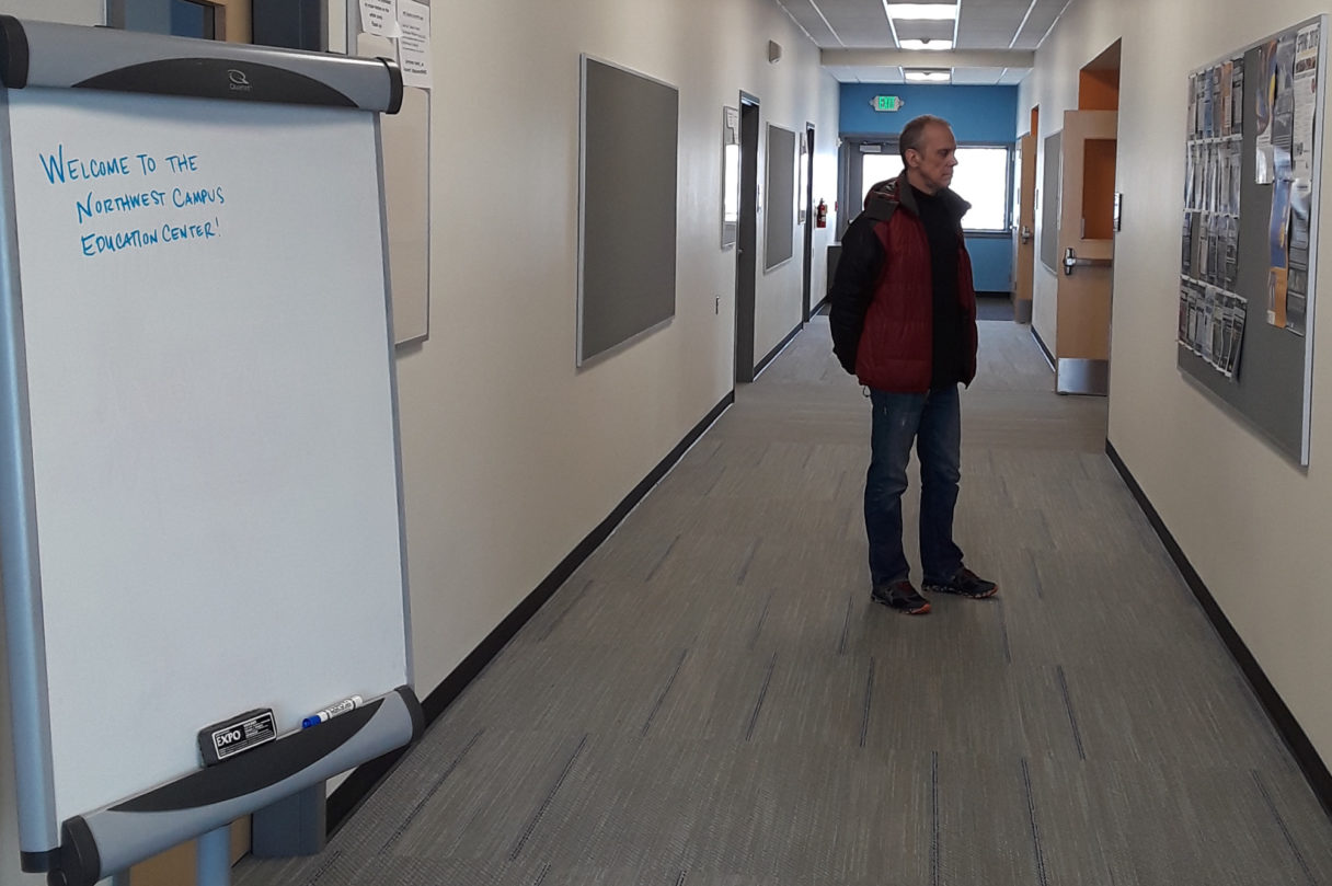 UAF Northwest Campus director, Bob Metcalf, stands in the hallway of the newly renovated education center. Photo Credit: Davis Hovey, KNOM (2018)