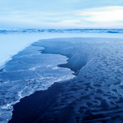 An aerial view of near-shore ocean ice near the village of Shaktoolik, Alaska.