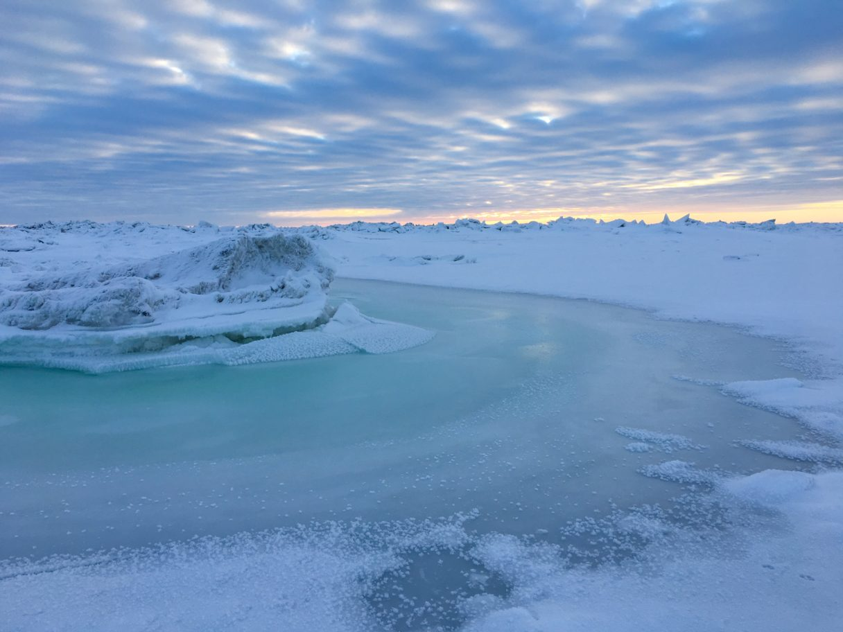 The beginning of a colorful sunset over the sea ice in Nome.