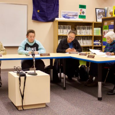 The Nome Public Schools Board of Education reviews the fiscal year 2019 budget before passing it (Photo: Gabe Colombo, KNOM)