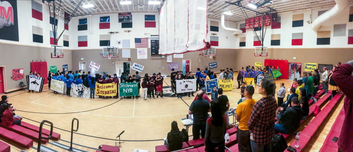 NYO teams gather inside the St. Michael gymnasium for a parade.