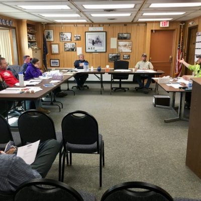 The Nome Port Commission sits around tables in Council Chambers in May 2018.
