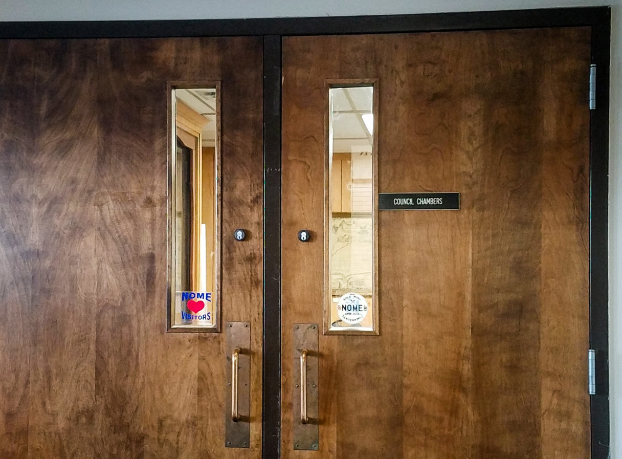"Double doors with a small placard reading ""Council Chambers."""