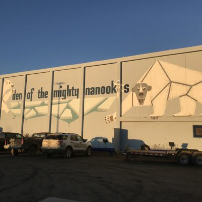 "Lettering outside on a building reads ""den of the mighty nanooks"""